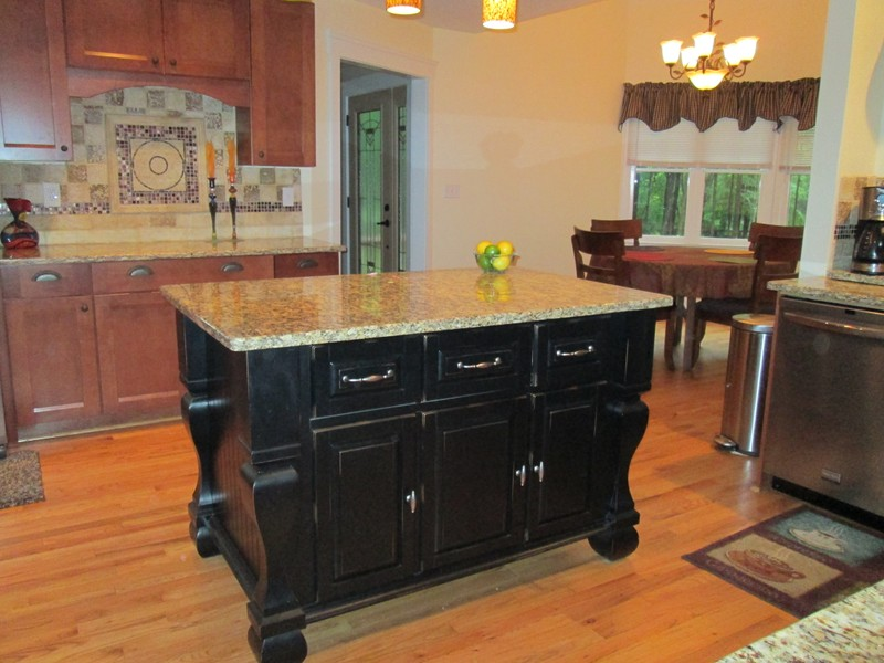 The attractive black kitchen island completed by back for Kitchen island cabinets